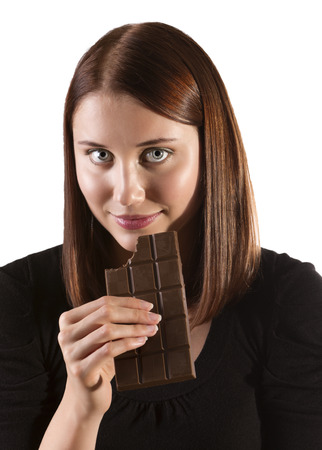 A beautiful woman satisfying a chocolate craving