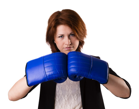 Businesswoman in suit punching with red boxing gloves isolated on white background photo