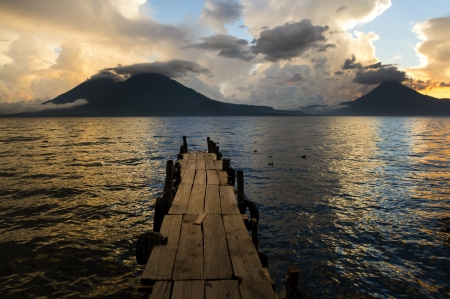 Sunset on Lake Atitlan with volcano in background Stock Photo - 24964977