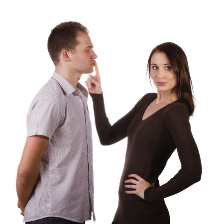 shut: Beautiful young woman quiets man, isolated on white Stock Photo