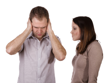 shutting: Man shutting his ears and not listening to the persistent yelling of his spouse