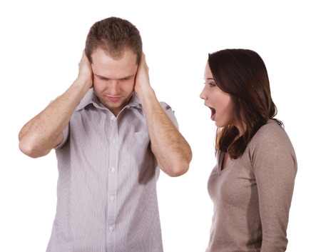 relationship problems: Man shutting his ears and not listening to the persistent yelling of his spouse