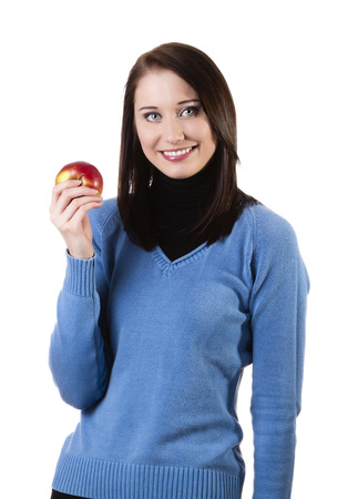 Beatiful young woman holding apple, isolated on white Stock Photo