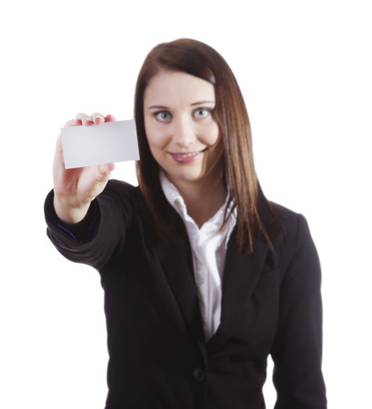 Young businesswoman holding white business card  empty paper sign with copy space. Beautiful caucasian xwoman isolated on white background (focus on card)