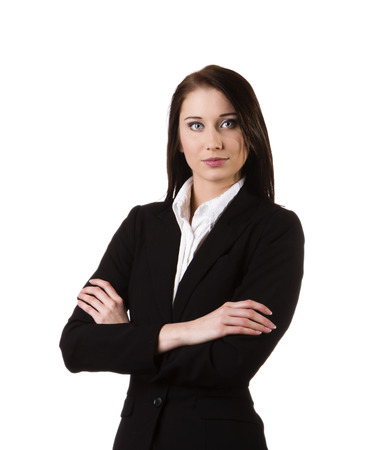 Businesswoman wearing a suit and confidently standing against white background