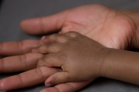 hand of a baby in his mother
