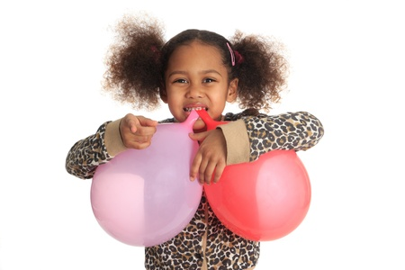 African American child and asian long hair with ball in mouth isolated metisse photo