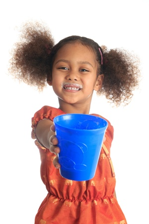 African American children and Asian long hair drinks milk metisse isolated