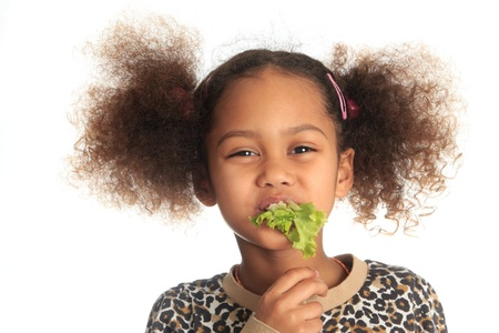 beautiful salad: beautiful asian child African American Black child eats salad isolated metisse Stock Photo