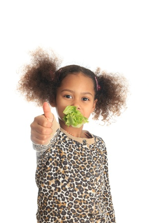 beautiful asian child African American Black child eats salad isolated metisse photo