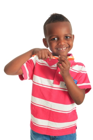 african american black child with a tooth brush isolated metisse hair curly photo