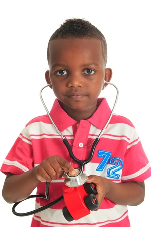 doctor toys: Black African American child with stethoscope and car isolated metisse hair curly