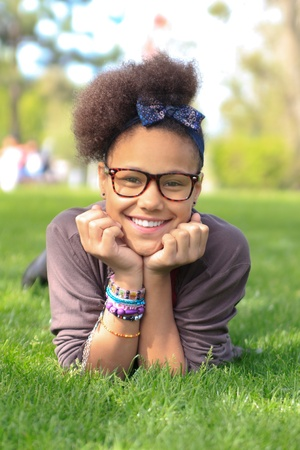 diversity children: african american black girl child to the park metisse african Stock Photo
