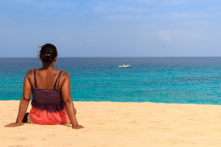relaxing beach woman with boat photo