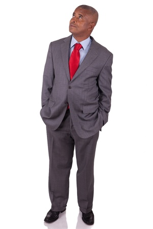 American business man standing on white with hands in pocket