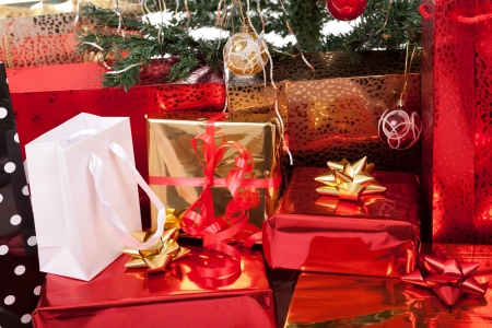 free gift: Christmas Tree and Gifts  Over white background  Stock Photo