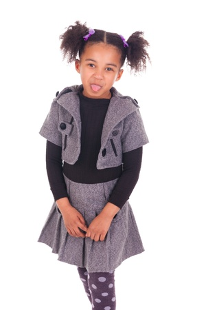 young African girl sticking tongue out, isolated on white background Stock Photo - 18231329