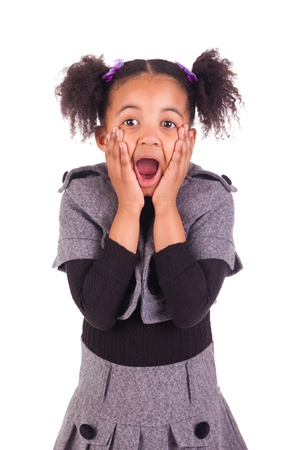 little girl surprised: young African girl sticking tongue out, isolated on white background