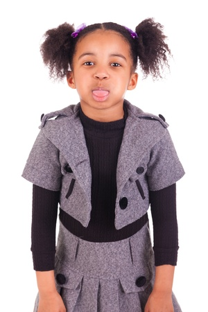 young African girl sticking tongue out, isolated on white background Stock Photo - 18231345