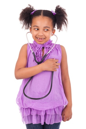 Black African American child with stethoscope isolated photo