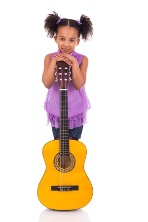 child singing: Young girl with guitar on white background