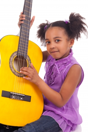artist's model: Young girl with guitar on white background