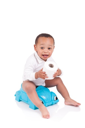 potty: Child on potty play with toilet paper, isolated over white