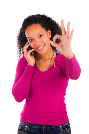 Portrait Of Young Girl african Talking On phone  isolated photo