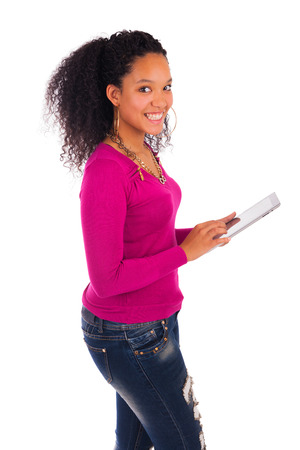 Portrait Of Young Happy African Woman Using Digital Tablet. photo