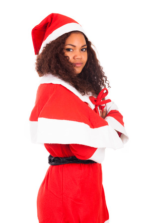 brazilian caribbean: Young African American woman wearing à santa hat, isolated on white background