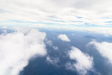 vast: Photograph taken above the clouds over the Pacific Ocean