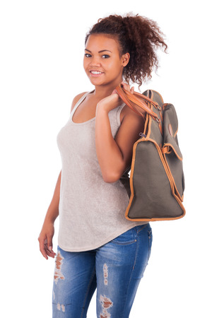 african fashion: Young African woman travelling with her bag - isolated