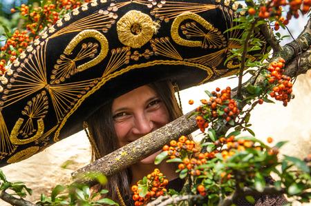 girl with sombrero smiling photo