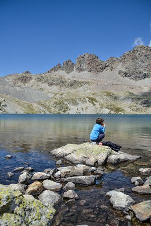 a child belong a mountain lake photo