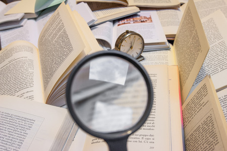 magnifyng glass and books photo