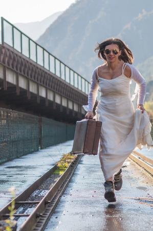 Escaping Bride on the Bridge photo