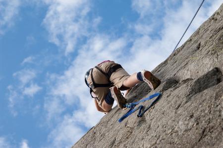 child climbs the cliff photo