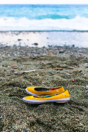 abandoned shoes on the beach photo
