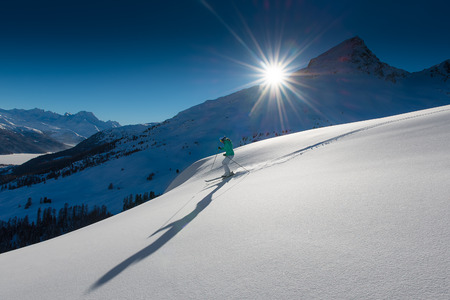 skiing accident: girl in off-piste skiing Stock Photo
