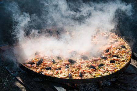 Cooking paella in large pot