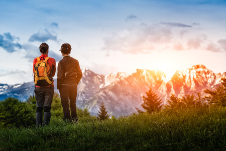 two girls look at the mountains while hiking photo