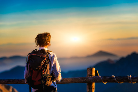 woman watching the sunset in the mountains Stock Photo - 34167924