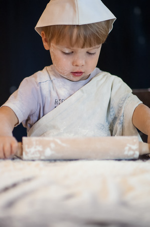 a child plays with the flour photo
