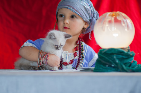 diviner: child fortune teller with her cat