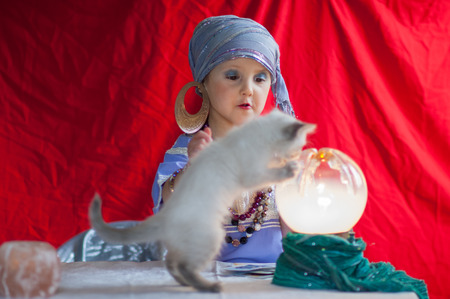 fortune teller: child fortune teller with her cat