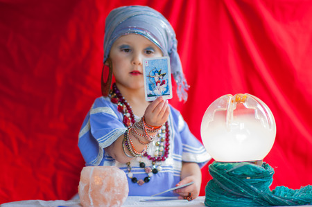 little child plays to be a fortune teller photo