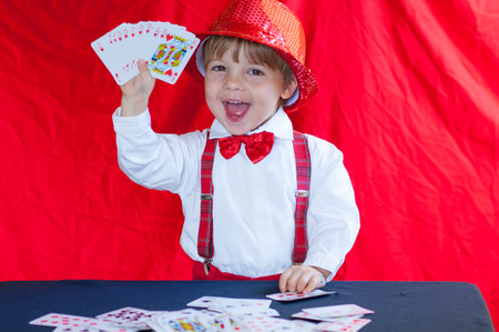 little child plays with playing cards photo