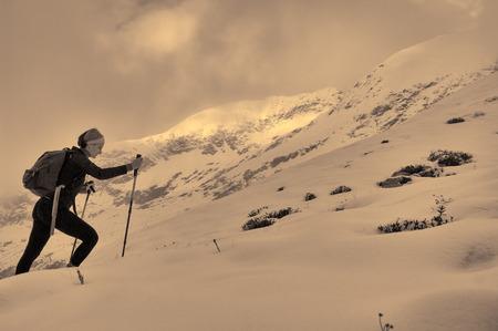 holiday maker: beautiful girl trekking on the mountain