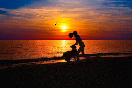 Girl with dog on the beach photo