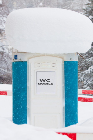 latrine: Mobile toilet covered in snow